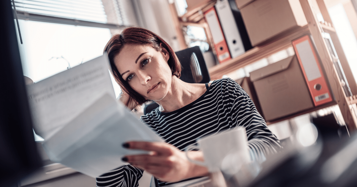 Frustrated woman looking over financials